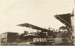 "Black and white photograph of a ""Boeing 1 F ""  flying boat outside the buildings of the Walsh Brothers Flying School; 1915-1927; 04/077/034"