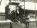 Black and white photograph of Vivian Walsh sitting at the controls of aeroplane 'Manurewa'; A. N. Breckon; 1911; 04/071/105