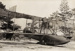Photograph of a Curtiss flying boat bi-plane being hauled on a trolley on rails up a beach; Unidentified; Circa 1918; 06/097/023