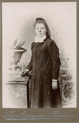 Portrait photograph of young woman; American Studios; 13-1044