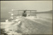 "Black and white photograph of Curtiss ""C"" seaplane of the Walsh Brothers Flying School taking off; 1916-1924; 04/071/102"