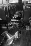 Photograph of littered bus interior; Les Downey; 1972-1976; 14-1114