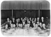 Group portrait of men seated in theatre; Unidentified; 1930s; 13-2183