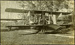 Black and white photograph of Walsh Brothers Flying School Curtiss Flying Boat e on the ground in the flying school; 1917; 04/077/021