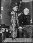 Boy dressed in costume, in living room; Unidentified; 1930s; 13-2115