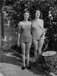 Two sisters standing by John George McGuire's backyard shed; J G McGuire; 1930s; 13-2203
