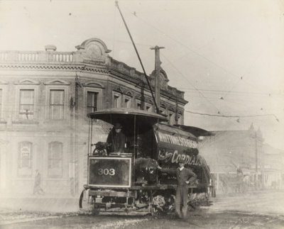 [Water-sprinkler tram no. 303 at the intersection of Khyber Pass Road and Broadway]; Unknown Photographer; [1902-1920]; PHO-2017-5.3