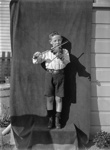 Boy Scout playing a fiddle; Unidentified; 1933; 13-2217