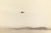 Photograph of a Curtis flying boat bi-plane in air flying passed North Head and Devonport; Unidentified; Circa 1918; 06/097/029