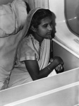 [Young Indian girl in a flying boat] ; Wilson and Horton Limited; [1950s]; 02/049/167