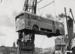 Floating crane Mahua unloading diesel bus; Graham C. Stewart (b.1932); 08/092/076