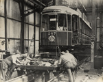 [Bogies being fitted to tram no. 247 the first Auckland streamliner with curved sides]; Unknown Photographer; 1938; PHO-2017-5.30