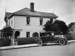 Victorian villa and 1925-1930 Buick (Doctors) Coupe; Unidentified; 1930s; 13-2241