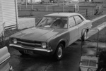Photograph of Ford car and lawnmower; Les Downey; 1972-1976; 14-2676