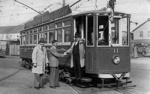 Three unidentified men are standing to the right of the front of the tram no, 11, taken during the visit of Charles Bowden; W.W. Stewart (b.1898, d.1976); 06-837