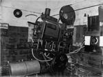 Cinema projector in projection room; J G McGuire; 1930s; 13-2143