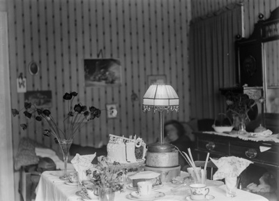 21st birthday cake on dining room table; Unidentified; 1930s; 13-2279
