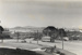 [Tram on Anzac Avenue showing a view of the Waitemata Harbour out to Devonport and Rangitoto Island]; Unknown Photographer; 07 Jul 1956; PHO-2017-5.28