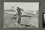 [Jean Batten in front of Percival Gull G-ADPR at Hatfield Aerodrome, England]; Unknown Photographer; [1935-1936]; PHO-0192-1.29
