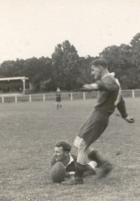 [A rugby player goes to kick the ball]; Unknown Photographer; Unknown; 14-0889