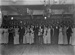 Group portrait at evening function in hall; Unidentified; 1930s; 13-2173