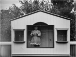 Young girl standing in bird aviary; Unidentified; 1930s; 13-2099