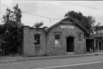 Photograph of old brick building, New Lynn; Les Downey; 1972-1976; 14-2166