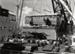 Floating crane Mahua unloading diesel bus; Graham C. Stewart (b.1932); 08/092/074