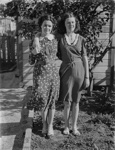 Two sisters standing by John George McGuire's backyard shed; J G McGuire; 1930s; 13-2202