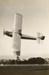 Photograph of a de Havilland Tiger Moth performing acrobatics; Unidentified; Circa 1920s; 06/097/052