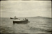 Black and white photograph of a motor boat on the harbour with a Walsh Brothers Flying School flying boat crashed in the water in the background; 1915-1924; 04/077/078