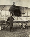 Black and white photograph of Miller and Sandford and their plane which was rebuilt from the Walsh brothers' Manurewa, Miller in the cockpit, Sandford standing; 1913; 04/077/068
