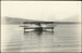 "Black and white photograph of Curtiss ""C"" flying boat of the Walsh Brothers Flying School landing on the beach, possibly Mission Bay; 1916-1920; 04/071/092"