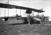 "Black and white photograph of "" Curtiss ""C"" flying boat being worked on by pupils of the Walsh Brothers Flying School; 1915-1927; 04/077/004"