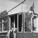 An unidentified man standing on the steps of the tram no. 11, taken during the visit of Charles Bowden; W.W. Stewart (b.1898, d.1976); 06-838