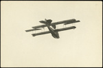 "Black and white photograph of Curtiss ""C"" flying boat of the Walsh Brothers Flying School in flight, taken from below; 1916-1920; 04/071/093"