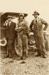Black and white photograph of Vivian Walsh, Dick Russell (in pilot's uniform) and Wally Ross standing in front of a car; 1915-1927; 04/077/040