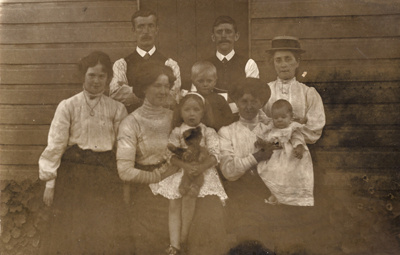 Group photograph of a family with children and baby; Unidentified; 13-1113