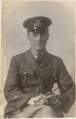 Black and white postcard of Walsh Brothers Flying School graduate Dick (Richard) Russell in uniform; 1915-1927; 04/077/029