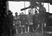 Black and white photograph of Walsh Brothers Flying School trainees beside a plane; 1915-1927; 04/077/009