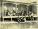 Black and white photograph of Walsh Brothers Flying School pilots on the verandah of the recreation hut at the school; 1915-1927; 04/077/020