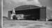 Teal Sandringham ZK-AME at Hobsonville, Catalina in hanger; Les Downey; 1940s; 05/026/007