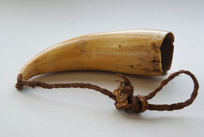 Tambua made of whale tooth ivory. It has a hole dr...