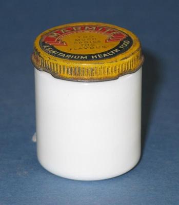 Small white-glass marmite jar. It has a tin screw ...