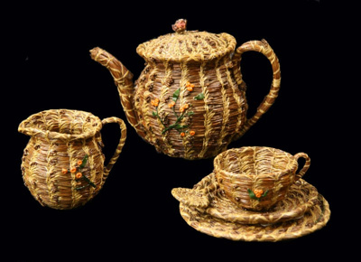 Tea set made with coiled bundles of brown pine nee...