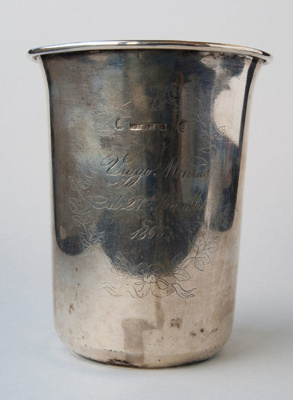 A beaker belonging ot the Monrad family ornately i...