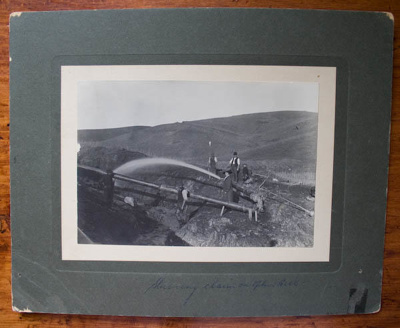 Photograph ['Sluicing claim on Ophir Hill']; 19th Century; XOPO.23