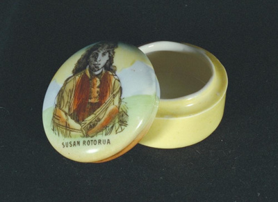 This small yellow souvenir ware porcelain containe...