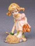 Statuette of a girl carrying a pair of shoes; Unknown; Unknown; 2008.32.108