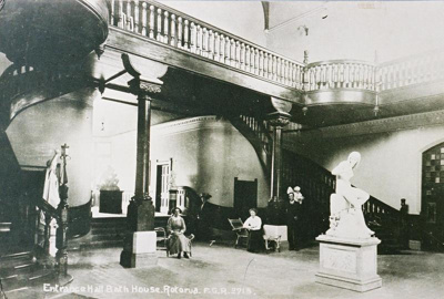View of the Bath House Foyer. The image shows scul...